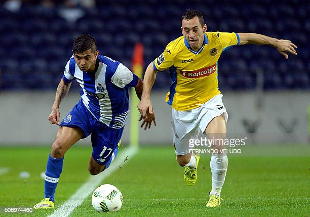 Porto's Mexican forward Jesus Corona vies with Arouca's defender Hugo Basto during the Portuguese League football match FC Porto vs FC Arouca at the...