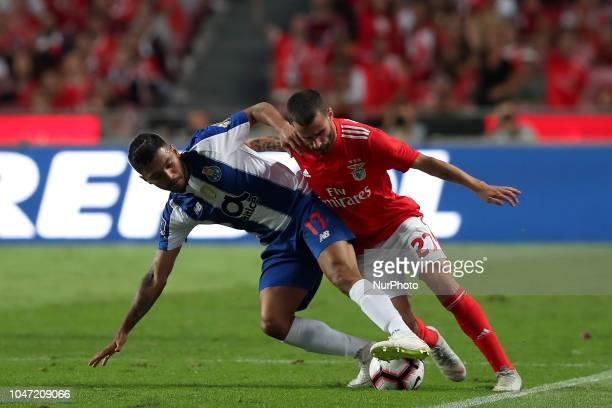 Porto's Mexican forward Jesus Corona vies with Benfica's Portuguese midfielder Rafa Silva during the Portuguese League football match SL Benfica vs...