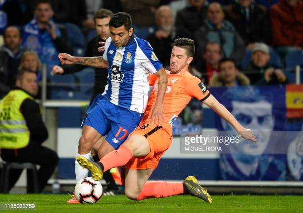 Porto's Mexican forward Jesus Corona vies with Boavista's Brazilian forward Gustavo Sauer during the Portuguese league football match between FC...