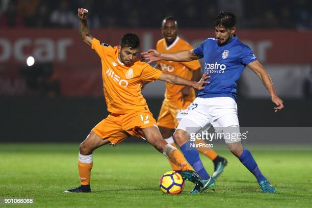 Porto's Mexican forward Jesus Corona vies with Feirense's Portuguese forward Hugo Seco during the Premier League 2016/17 match between CD Feirense...