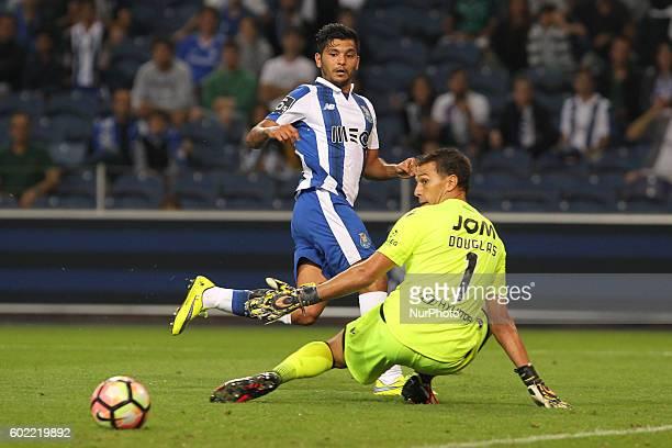Porto's Mexican forward Jesus Corona with Vitoria SC's Brazilian goalkeeper Douglas during Premier League 2016/17 match between FC Porto and Vitoria...