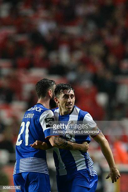 Porto's Mexican midfielder Hector Herrera celebrates a goal with teammate Porto's Mexican defender Miguel Layun during the Portuguese league football...