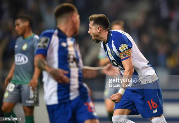 Porto's Mexican midfielder Hector Herrera celebrates after scoring a goal during the Portuguese League football match between Porto and Vitoria...