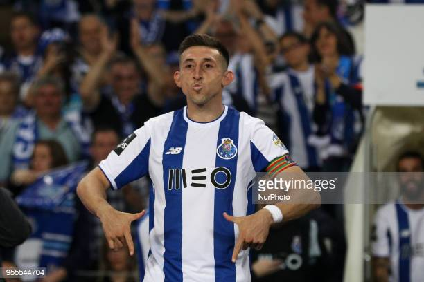 Porto's Mexican midfielder Hector Herrera celebrates the title of national champion during the Premier League 2017/18 match between FC Porto and CD...