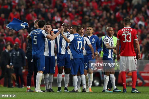 Porto's Mexican midfielder Hector Herrera celebrates with teammates at the end of the Portuguese League football match SL Benfica vs FC Porto at the...