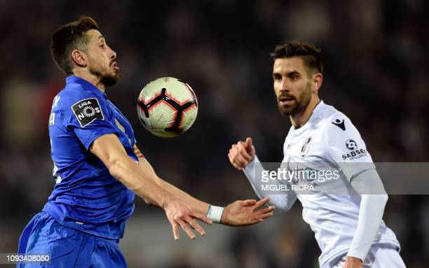 Porto's Mexican midfielder Hector Herrera controls the ball beside Vitoria Guimaraes' Portuguese defender Frederico Venancio during the Portuguese...
