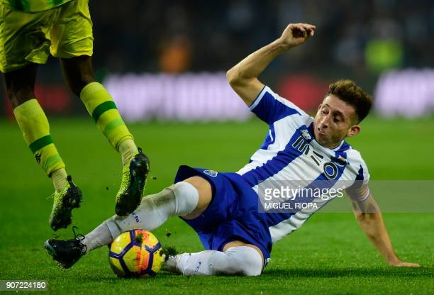 Porto's Mexican midfielder Hector Herrera does a tackle during the Portuguese league football match between FC Porto and CD Tondela at the Dragao...