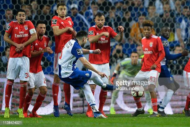 Porto's Mexican midfielder Hector Herrera takes a free kick during the Portuguese League football match between FC Porto and SL Benfica at the Dragao...