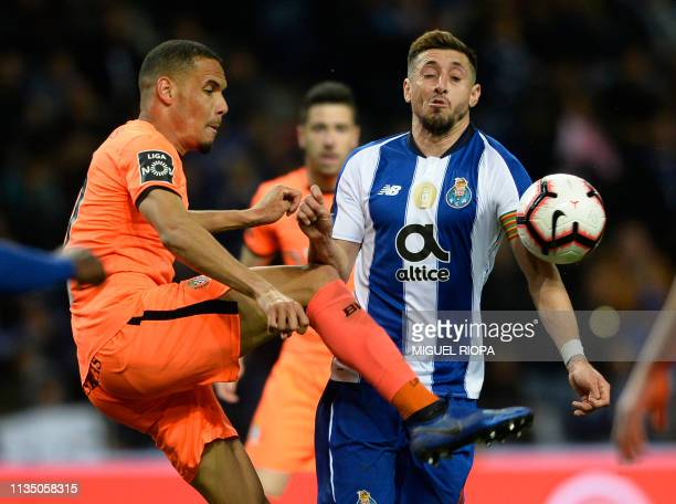 Porto's Mexican midfielder Hector Herrera vies with Boavista's Brazilian defender Neris during the Portuguese league football match between FC Porto...