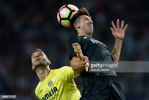 FC Porto's Mexican midfielder Herrera heads the ball with Villareal's midfielder Samu Castillejo during their friendly football match at the Dragao...