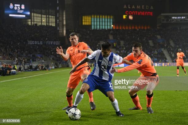 Porto's Mexican striker Jesus Corona is closed down by Liverpool's English midfielder James Milner and Liverpool's Scottish defender Andrew Robertson...