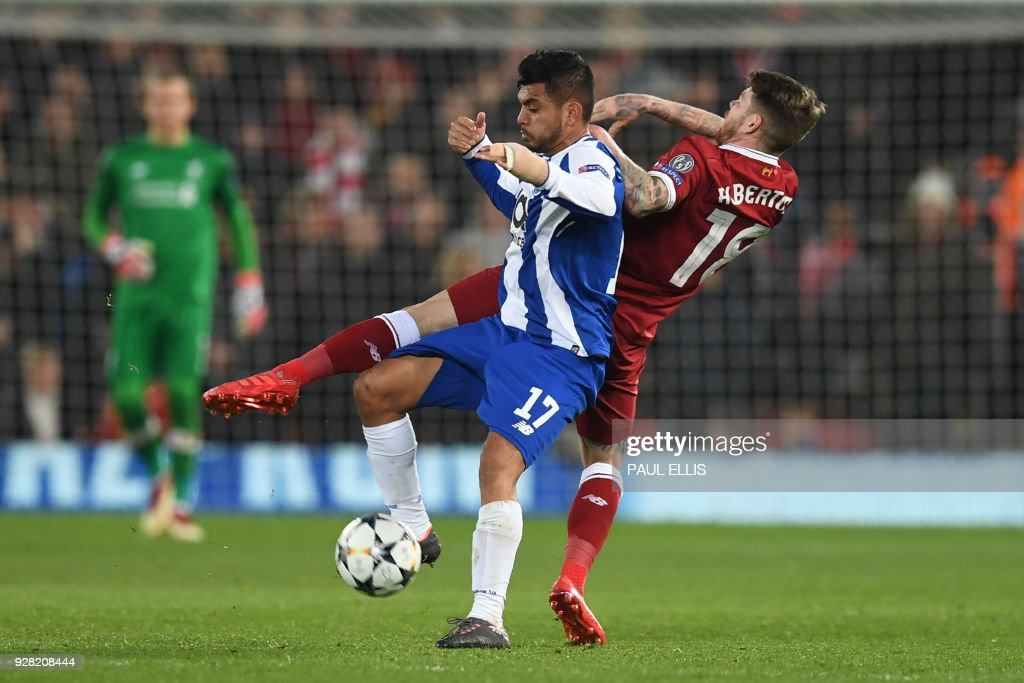 Porto's Mexican striker Jesus Corona (L) vies with Liverpool's Spanish defender Alberto Moreno during the UEFA Champions League round of sixteen second leg football match between Liverpool and FC Porto at Anfield in Liverpool, north-west England on March 6, 2018. / AFP PHOTO / Paul ELLIS
