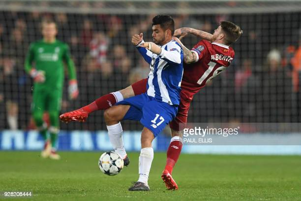 Porto's Mexican striker Jesus Corona vies with Liverpool's Spanish defender Alberto Moreno during the UEFA Champions League round of sixteen second...