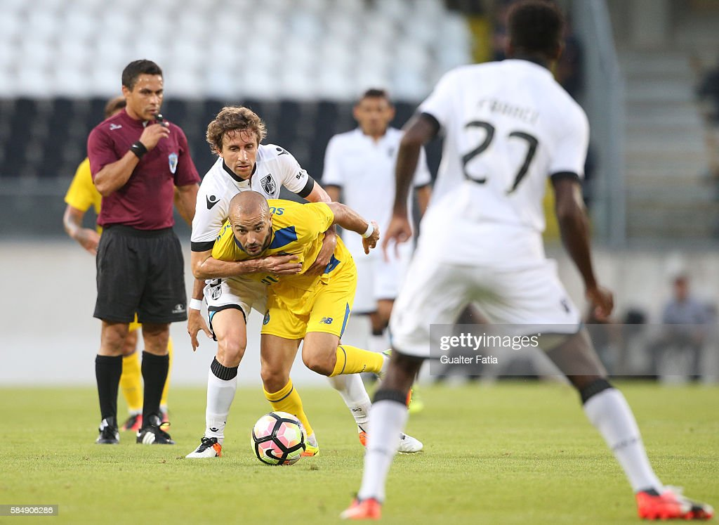 FC PortoÕs midfielder Andre Andre tackled by Guimaraes's midfielder Rafael Miranda during the Guimaraes City Trophy match between Vitoria de Guimaraes and FC Porto at Estadio D. Afonso Henriques on July 31, 2016 in Guimaraes, Portugal.