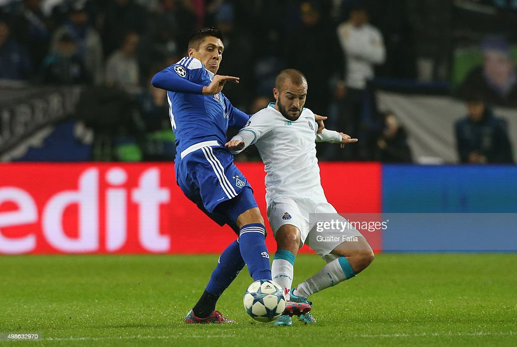 FC PortoÕs midfielder Andre Andre with FC Dynamo KyivÕs defender Yevhen Khacheridi in action during the UEFA Champions League match between FC Porto and FC Dynamo Kyiv at Estadio do Dragao on November 24, 2015 in Porto, Portugal.