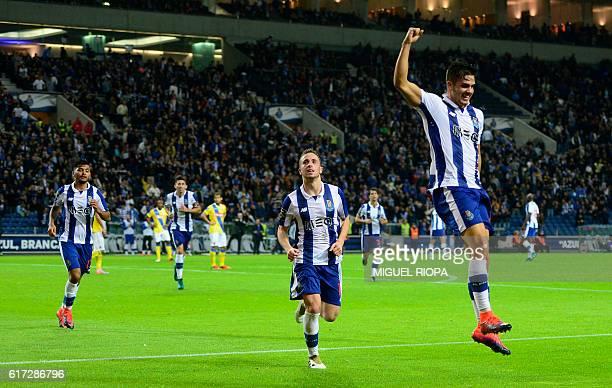 Porto's midfielder Andre Silva celebrates after scoring a goal during the Portuguese league football match FC Porto vs FC Arouca at the Dragao...