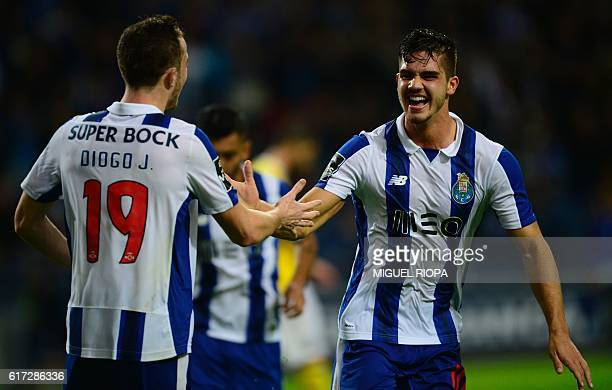 Porto's midfielder Andre Silva celebrates with teammate forward Diogo Jota after scoring a goal during the Portuguese league football match FC Porto...