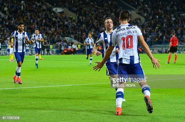 Porto's midfielder Andre Silva celebrates with teammates after scoring a goal during the Portuguese league football match FC Porto vs FC Arouca at...
