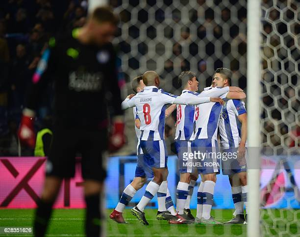 Porto's midfielder Andre Silva celebrates with teammates after scoring a goal during the UEFA Champions League football match FC Porto vs Leicester...
