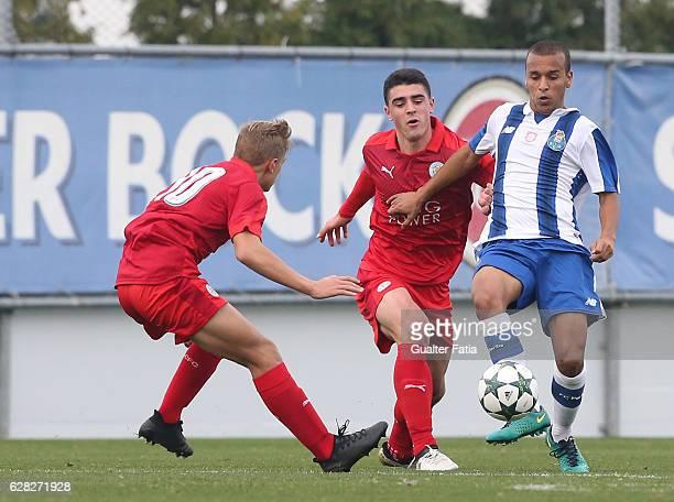 Porto's midfielder Ayoub Abou with Alexandru Pascanu of Leicester City FC and Kiernan DewsburyHall of Leicester City FC in action during the UEFA...