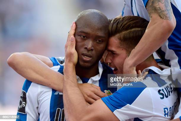 Porto's midfielder Danilo Pereira celebrates with teammates after scoring a goal during the Portuguese league football match FC Porto vs Belenenses...