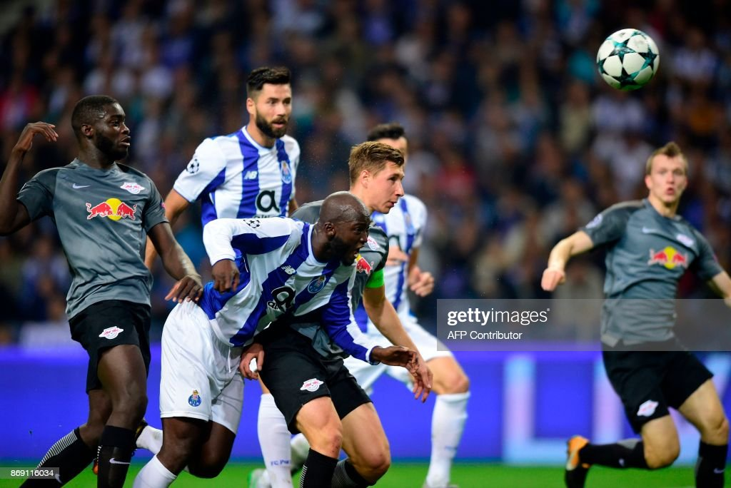 Porto's midfielder Danilo Pereira (C) heads the ball next to Leipzig's defender Willy Orban (back C) to score a goal during the UEFA Champions League group G football match FC Porto vs Leipzig at Dragao stadium in Porto on November 1, 2017. /