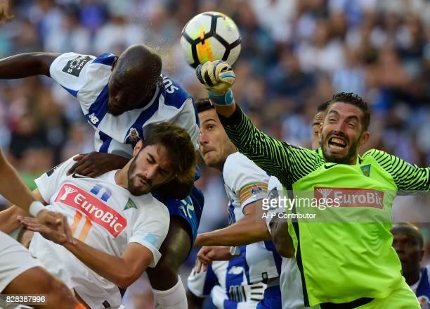 Porto's midfielder Danilo Pereira heads the ball over Estoril's defender Pedro Monteiro as he vies with Estoril's goalkeeper Moreira during the...