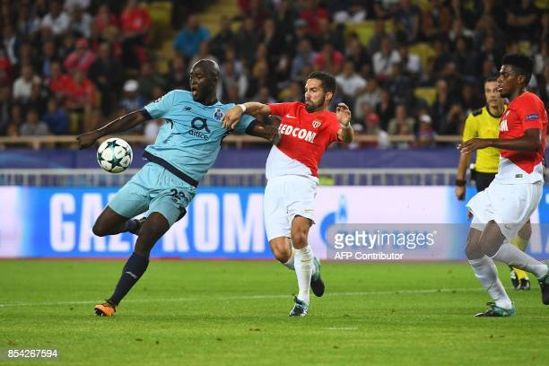 Porto's midfielder Danilo Pereira shoots on goal before Monaco's Portuguese midfielder Joao Moutinho prior to Porto's first goal during the UEFA...