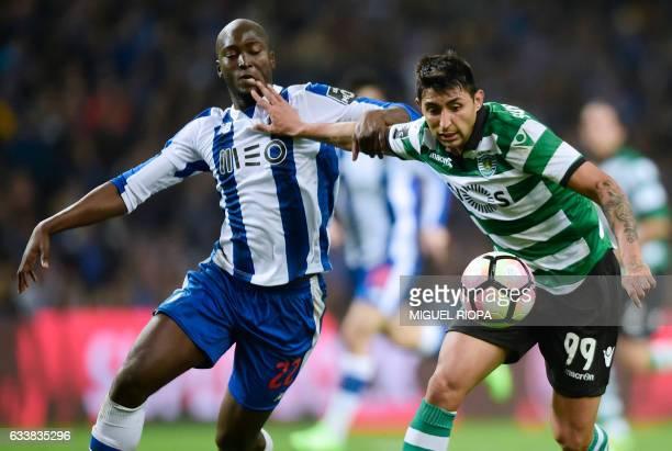 Porto's midfielder Danilo Pereira vies with Sporting's Argentinian forward Alan Ruiz during the Portuguese league football match FC Porto vs Sporting...