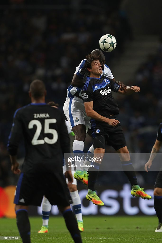 FC Porto's midfielder from Portugal Danilo Pereira (B) higher that of FC Copenhagen's midfielder William Kvist (F) heads the ball during the UEFA Champions League match between FC Porto v FC Copenhagen at Estadio do Dragao on September 14, 2016 in Lisbon, Portugal.