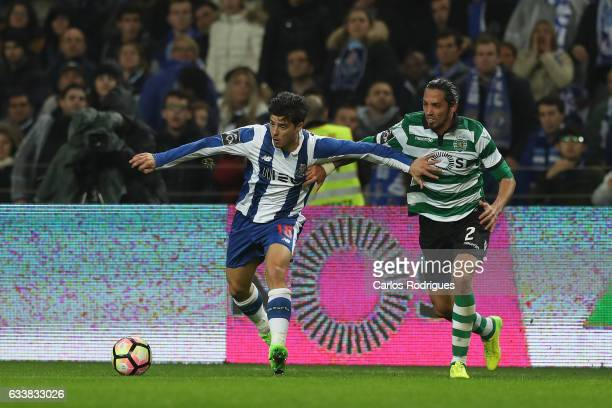 Porto's midfielder Joao Carlos Teixeira vies with Sporting CP's defender Ezequiel Schelotto from Argentina during the FC Porto v Sporting CP Primeira...