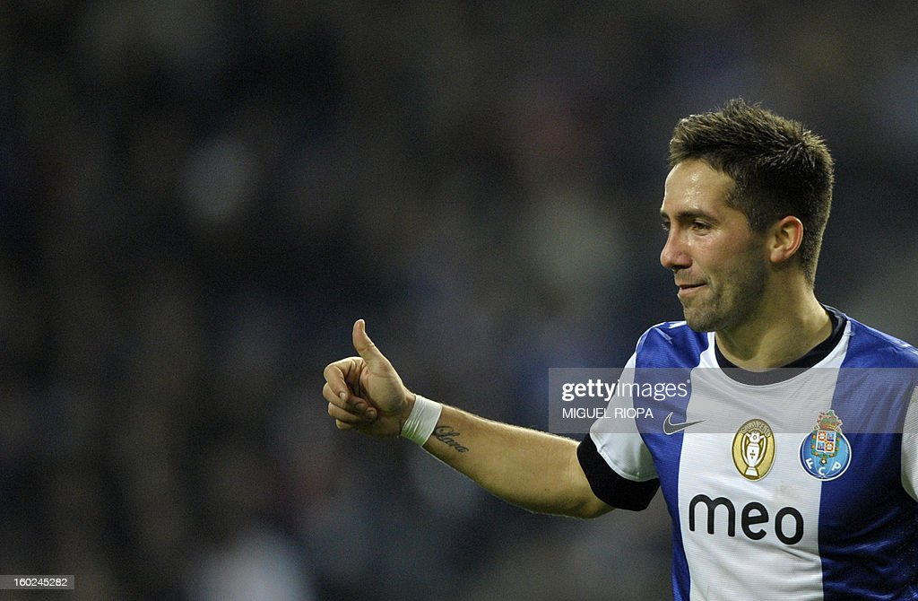 Porto's midfielder Joao Moutinho gives the thumbs up during the Portuguese league football match FC Porto vs Gil Vicente at the Dragao Stadium in Porto on January 28, 2013. Porto won the match 5-0.