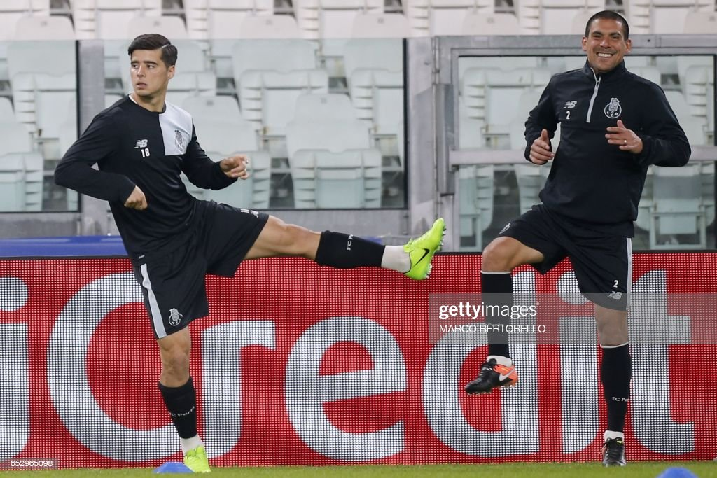 Porto's midfielder Joao Teixeira from Portugal (L) and Porto's defender Maxi Pereira from Uruguay take part in a training session on the eve of the UEFA Champions League football match Juventus Vs FC Porto on March 13, 2017 at the 'Juventus Stadium' in Turin. / AFP PHOTO / Marco BERTORELLO