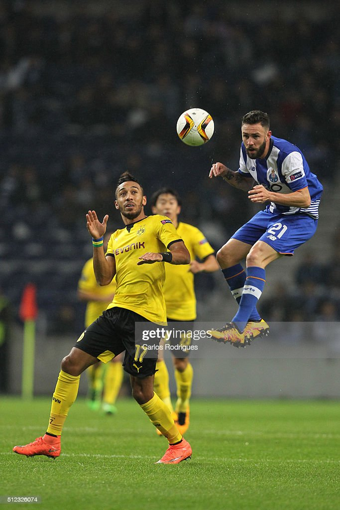 Porto's midfielder Miguel Layun higher than Dortmund's forward Aubameyang heads the ball during the Champions League match between FC Porto and Borussia Dortmund for UEFA Europa League Round of 32: Second Leg at Estadio do Dragao on February, 2016 in Porto, Portugal.