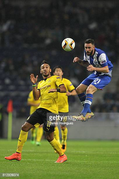 Porto's midfielder Miguel Layun higher than Dortmund's forward Aubameyang heads the ball during the Champions League match between FC Porto and...