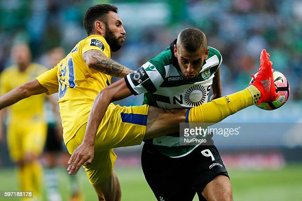 Porto's midfielder Miguel Layun vies for the ball with Sporting's forward Islam Slimani during Premier League 2016/17 match between Sporting CP v FC...