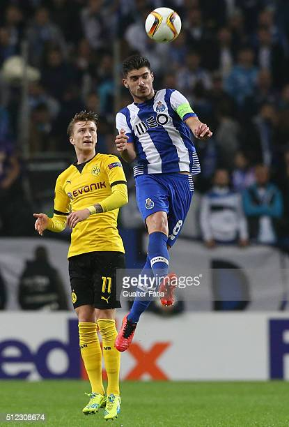 Porto's midfielder Ruben Neves with Borussia Dortmund's midfielder Marco Reus in action during the UEFA Europa League Round of 32 Second Leg match...