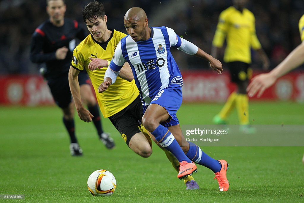 Porto's midfielder Yacine Brahimi (F) tries to escape Dortmund's midfielder Julian Weigl (B) during the Champions League match between FC Porto and Borussia Dortmund for UEFA Europa League Round of 32: Second Leg at Estadio do Dragao on February, 2016 in Porto, Portugal.