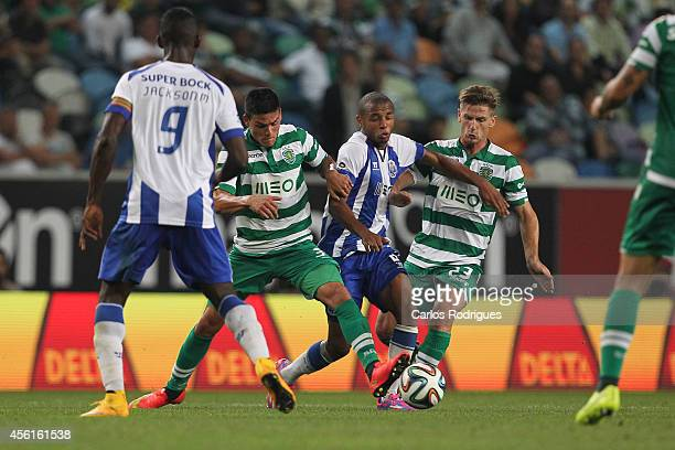 Porto's midfielder Yacine Brahimi tries to escape Sporting's defender Jonathan Silva and Sporting's midfielder Adrien Silva during the Primeira Liga...