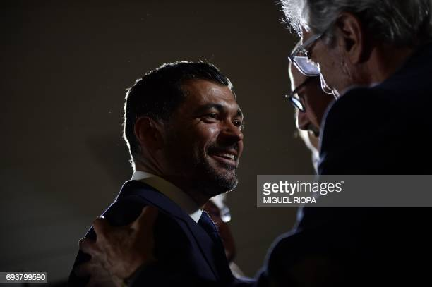 FC Porto's new coach Sergio Conceicao is congratulated after his official presentation at the Dragao stadium in Porto on June 8 after signing his new...