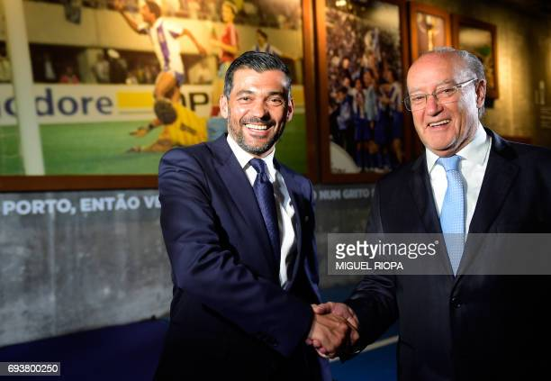 FC Porto's new coach Sergio Conceicao shakes hands with Porto's President Jorge Nuno Pinto da Costa during his official presentation at the Dragao...