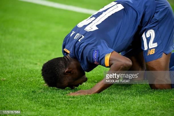 Porto's Nigerian defender Zaidu Sanusi celebrates after scoring a goal during the UEFA Champions League Group C second-leg football match between...