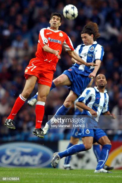 FC Porto's Nuno Valente and Deportivo La Coruna's Juan Valeron battle for the ball in the air