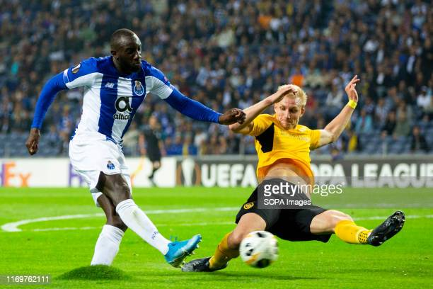 Porto's player Moussa Marega and Young Boys's player Frederik Sorensen are seen in action during the UEFA Europa League match between FC Porto and...