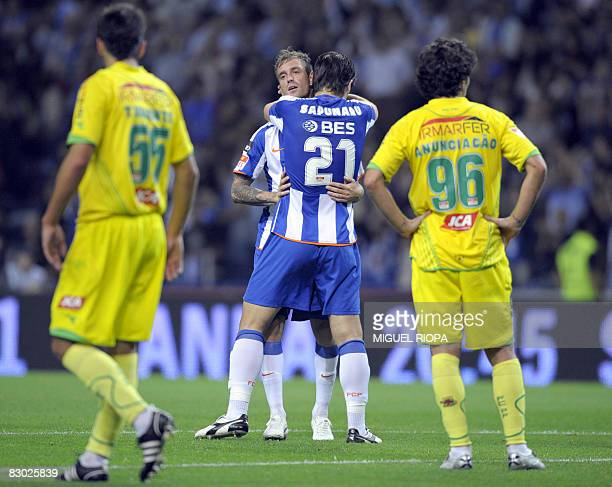 FC Porto's player Raul Meireles celebrates with teammate Romanian Cristian Sapunaru after scoring against Pacos Ferreira during their Portuguese...