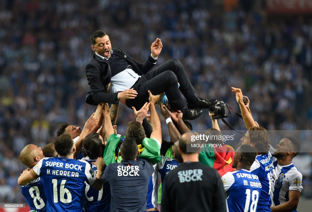 Porto's players carry their Portuguese coach Sergio Conceicao as they celebrate winning the league title after the Portuguese league football match between FC Porto and CD Feirense at the Dragao stadium in Porto on May 6, 2018.