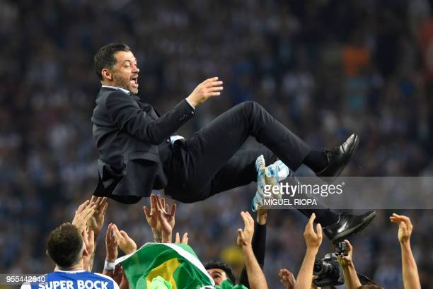 TOPSHOT Porto's players carry their Portuguese coach Sergio Conceicao as they celebrate winning the league title after the Portuguese league football...