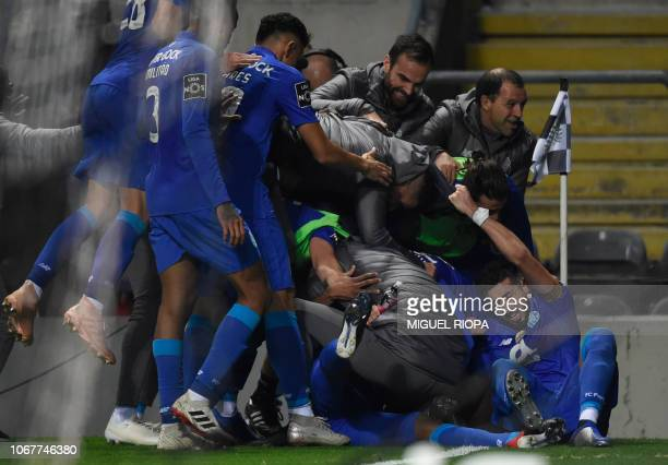 Porto's players celebrate a goal scored by Portuguese forward Hernani during the Portuguese league football match between Boavista FC and FC Porto at...
