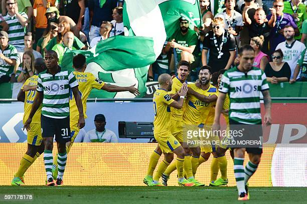 Porto's players celebrate after Porto's Mexican defender Miguel Layun scored against Sporting CP during the Portuguese league football match Sporting...