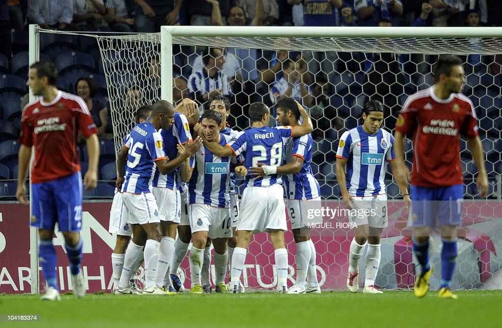 FC Porto´s players celebrate after scoring against Rapid Vienna during their UEFA Europa League football match at the Dragao Stadium in Porto, on September 16, 2010.